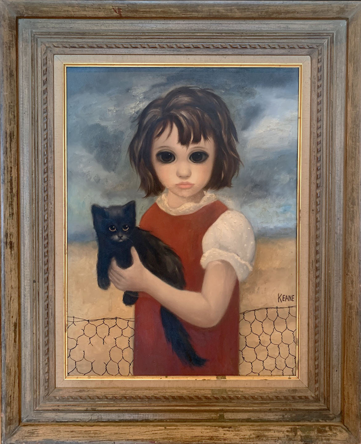 girl in red with black cat